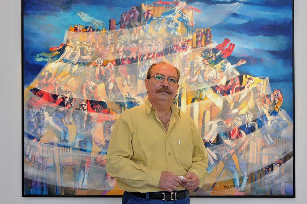 """Saad Yagan with """"Aleppo's Fortress"""" in the background"""
