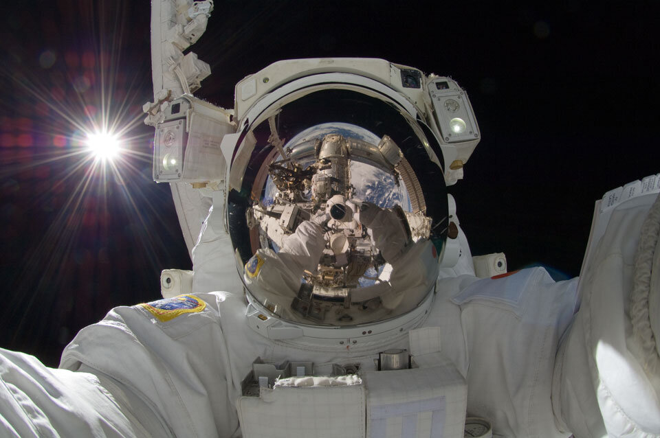 An astronaut takes a selfie in space