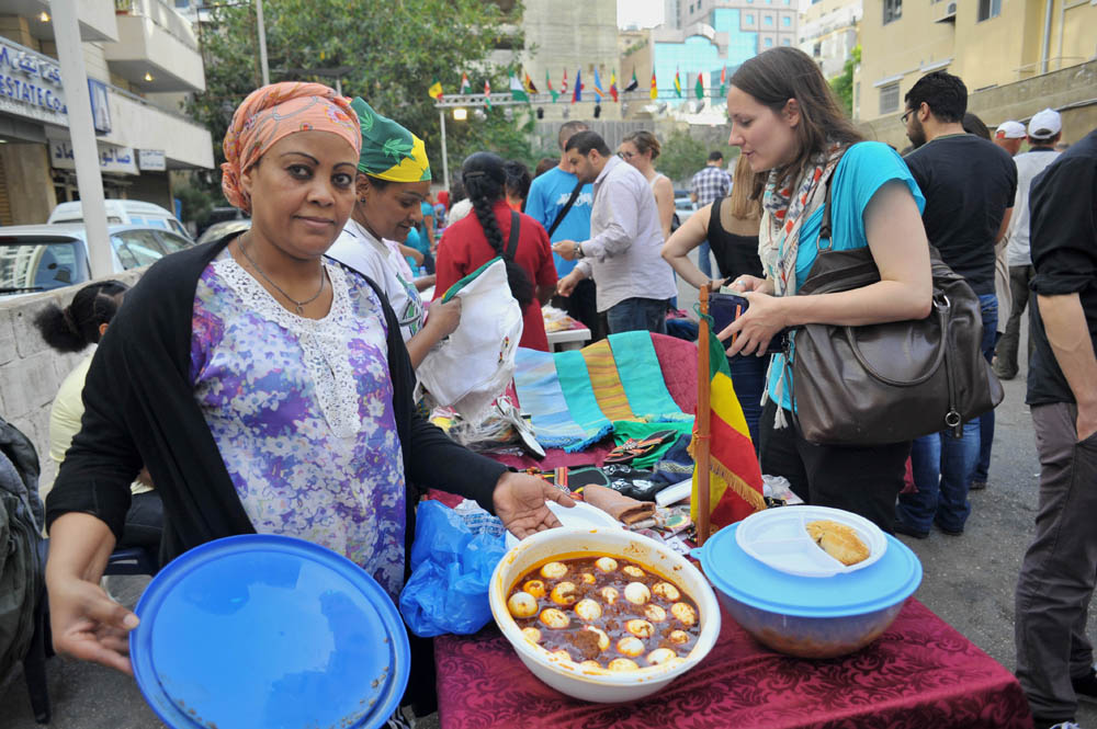 A woman showcases her food dishes