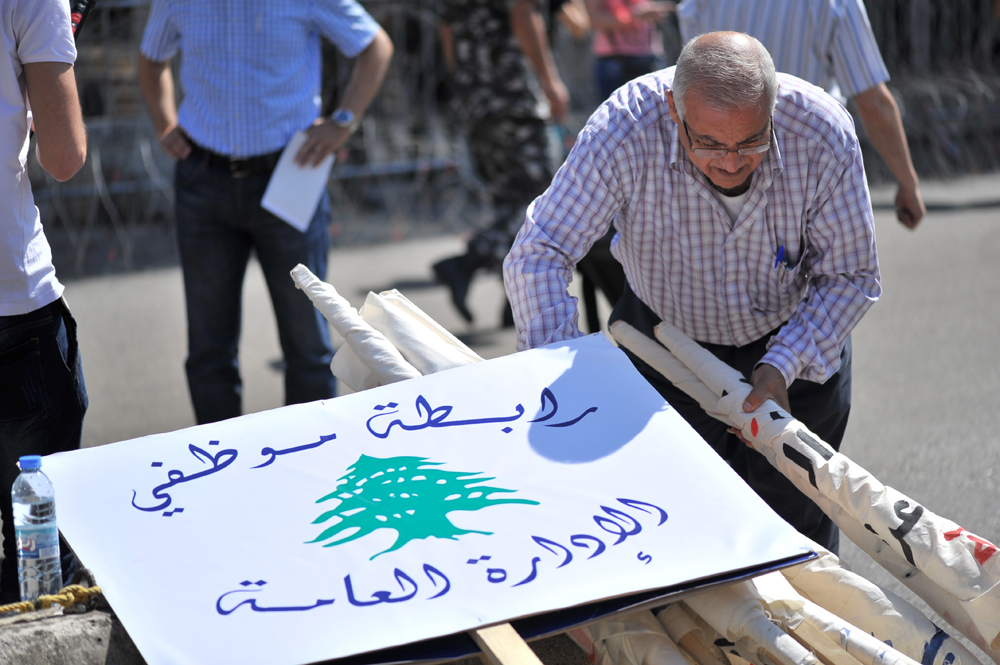 The organizers prepare their signs for the demonstration