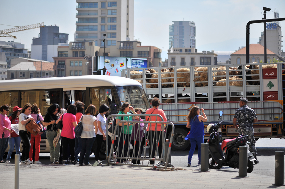 Buses drop off protesters coming from all corners of Lebanon