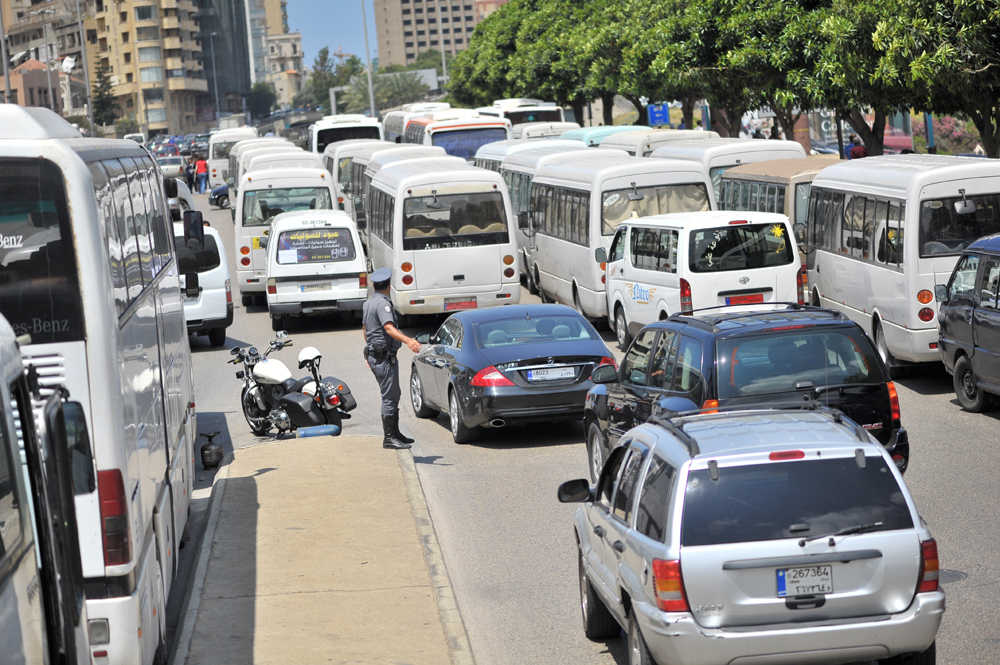 Dozens of buses parked near Riad el-Solh waited to pick protestors up after the protest