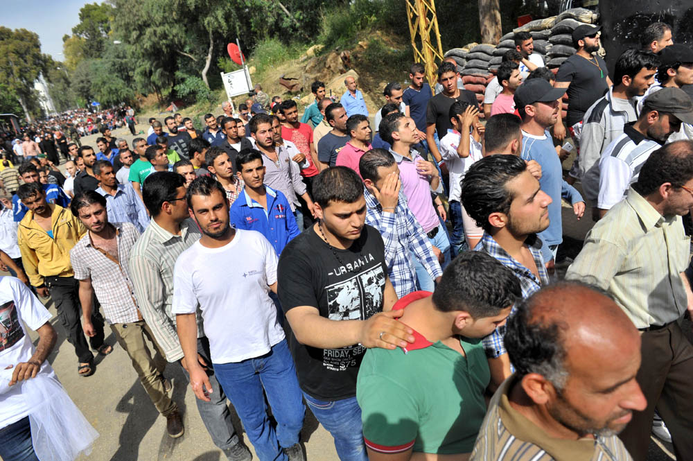 Thousands of Syrians waited for hours in front of their embassy in Yarze to vote