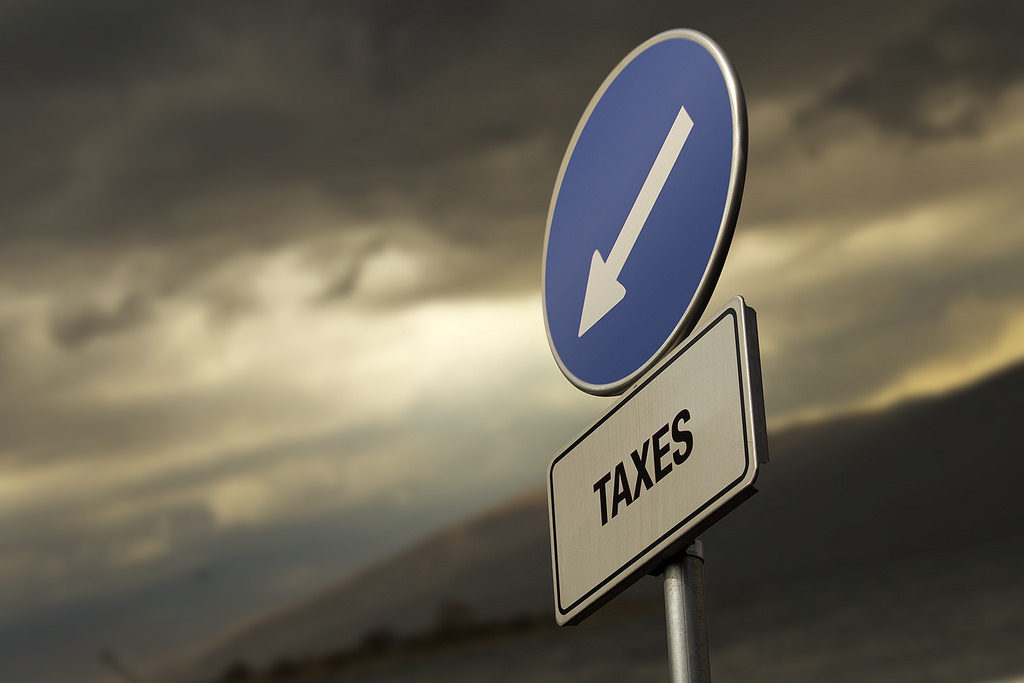 A street sign providing directions to taxes