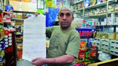 Brahim shows the rent contract of his parents' apartment. He owns a shop in Mar Elias district in Beirut. He makes around $660 per month of which he pays $220 for his parents' rent. With the new law, he says he will not be able to support his parents.