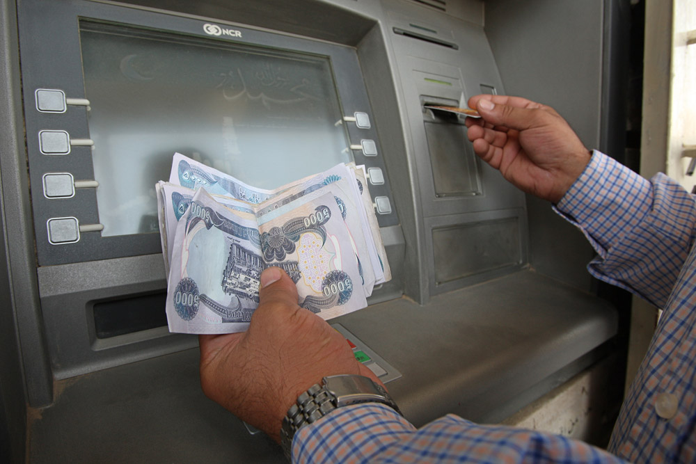A User Withdraws Money From The Iraqi Warka Bank Atm Automatic Teller Machine In