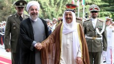 Iranian President Hassan Rouhani (C-L) greets Emir of Kuwait, Sheikh Sabah al-Ahmad Al Sabah (C-R) upon his arrival in Tehran on June 1, 2014. Kuwait's Emir started a landmark visit to Tehran focused on mending fences between Shiite Iran and the Sunni-ruled monarchies in the Gulf. AFP PHOTO/ATTA KENARE