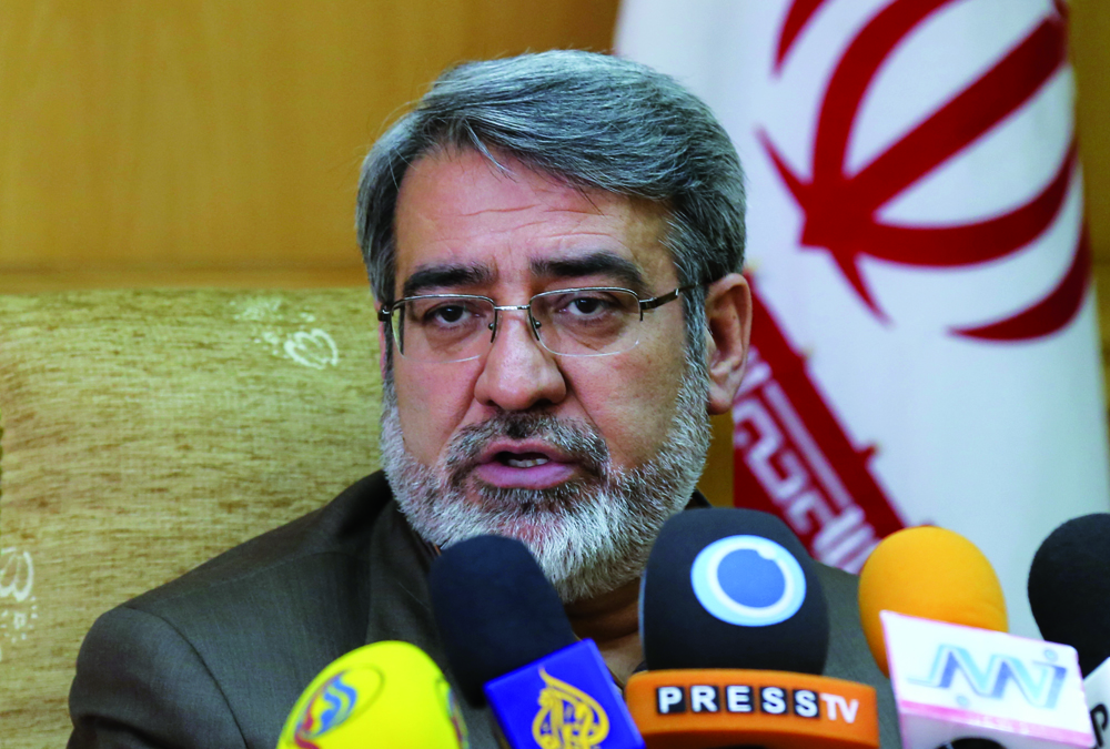 Iranian Interior Minister Abdolreza Rahmani Fazli speaks during press conference in which he announced Iran has seized 530 tons of illegal drugs since April 2013, on March 18, 2014 in Tehran. AFP PHOTO/ATTA KENARE