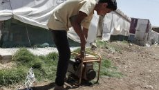The proportion of Syrian refugees who are food secure has fallen from 32 percent in 2013 to 11 percent in 2015. In this photo, taken in 2014, Ahmed, 15, from Raqqa starts a generator to provide electricity for his family's tent in an encampment for refugees in Lebanon's Bekaa Valley. Lack of power makes it impossible to keep food in such circumstances. European Commission | Flickr | CC BY-SA 2.0