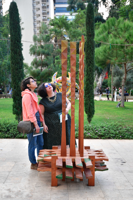 Lebanese artist Chaouki Choukini's wooden sculpture incorporates Arabic poetry | Photo: Greg Demarque