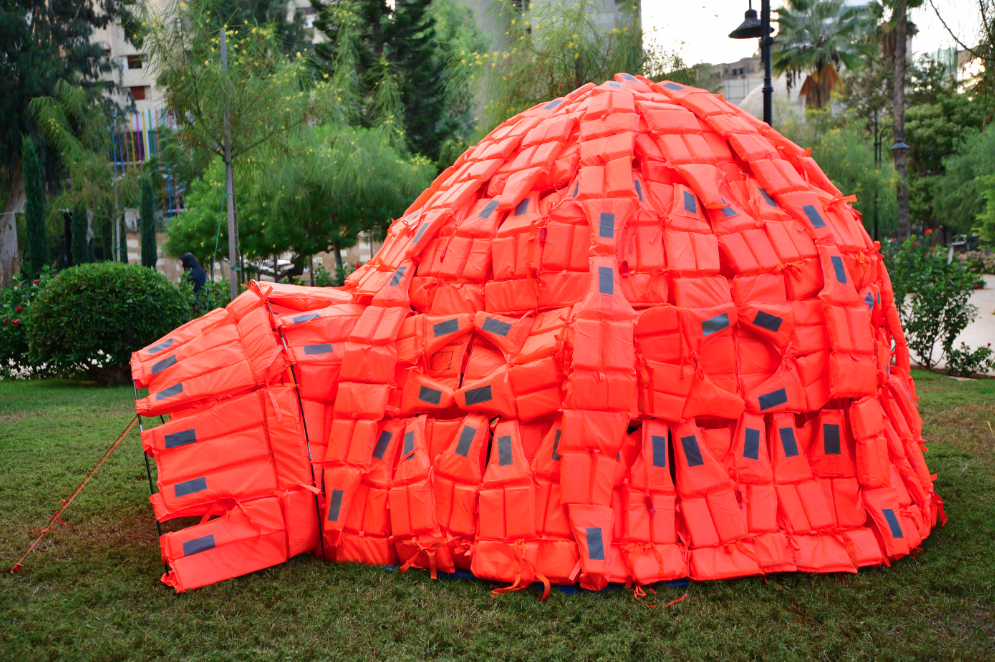 """Belgium's Cathy Weyders made """"Rescue Igloo, Moving Worlds"""" with life-jackets on site in the garden 